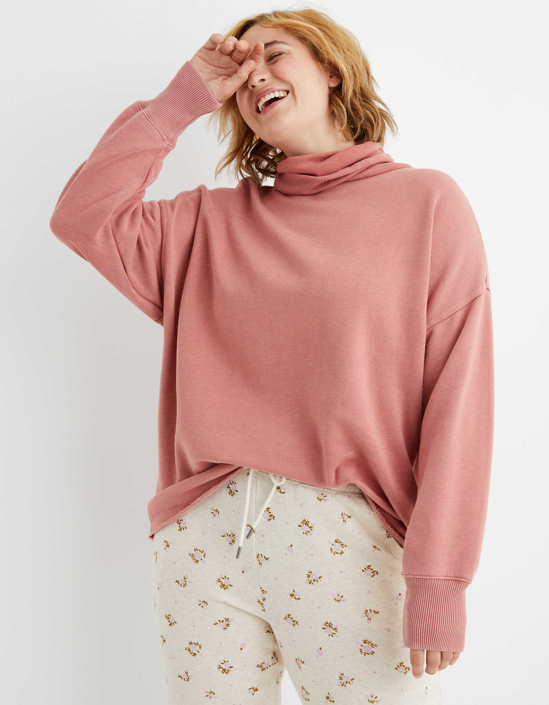 Model wearing the fleece sweatshirt with a slouchy turtleneck and dropped shoulder