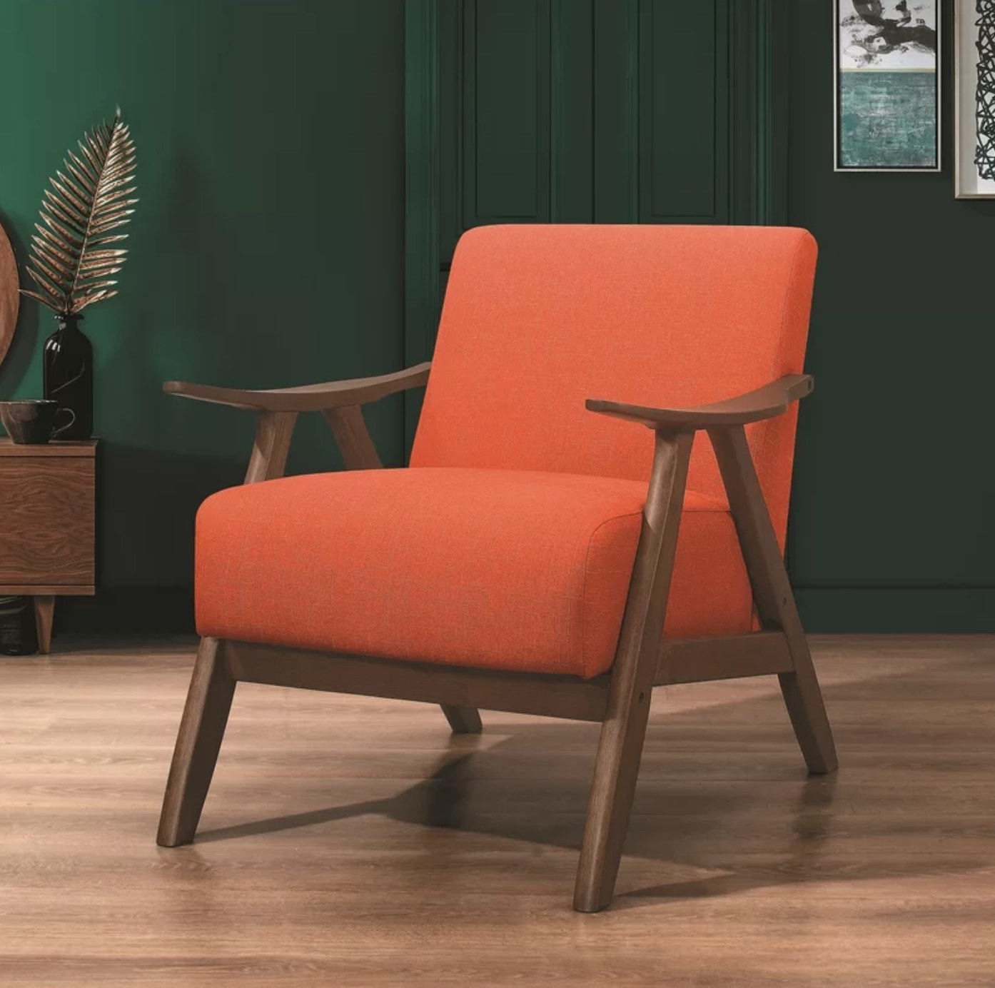 The mid-century armchair in orange polyester