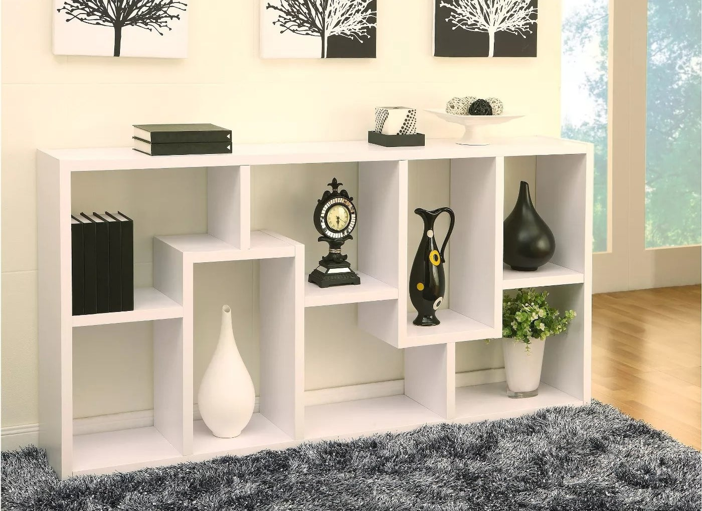 A white bookcase with geometric shelving