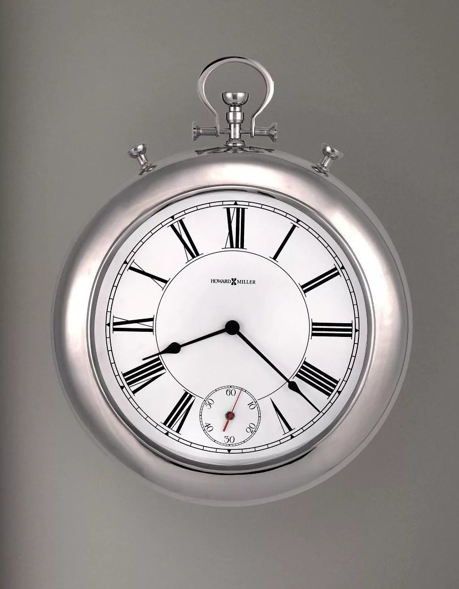 Silver wall clock shaped like old-fashioned pocketwatch