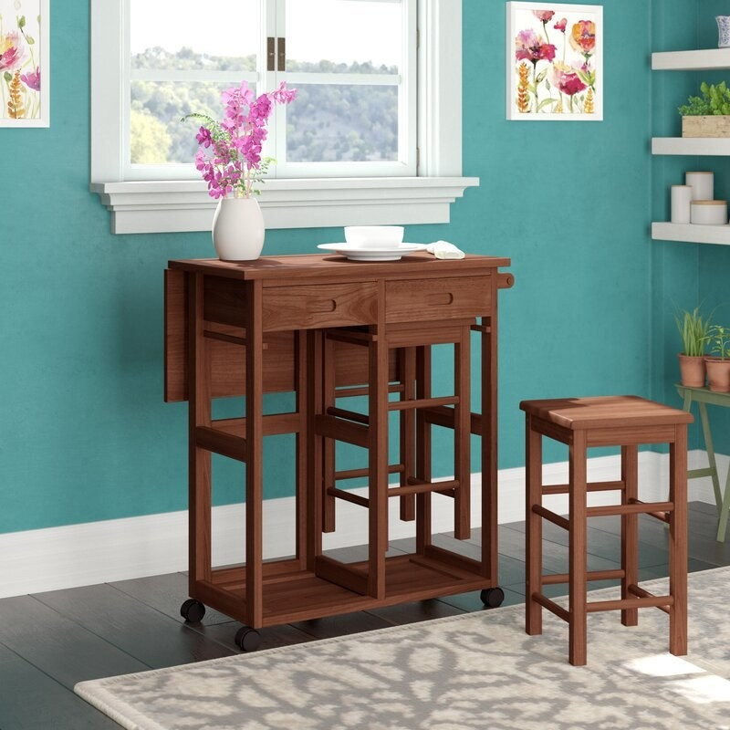 Wooden drop leaf table set with two matching stools