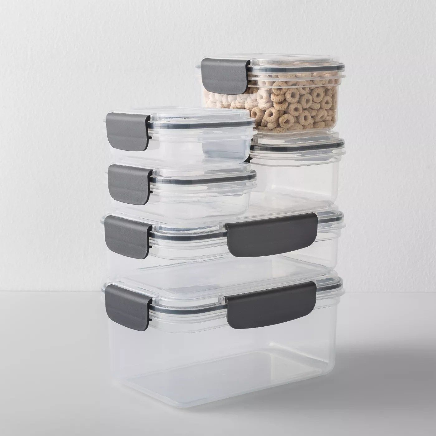 The storage containers stacked on top of each other, including one filled with cereal