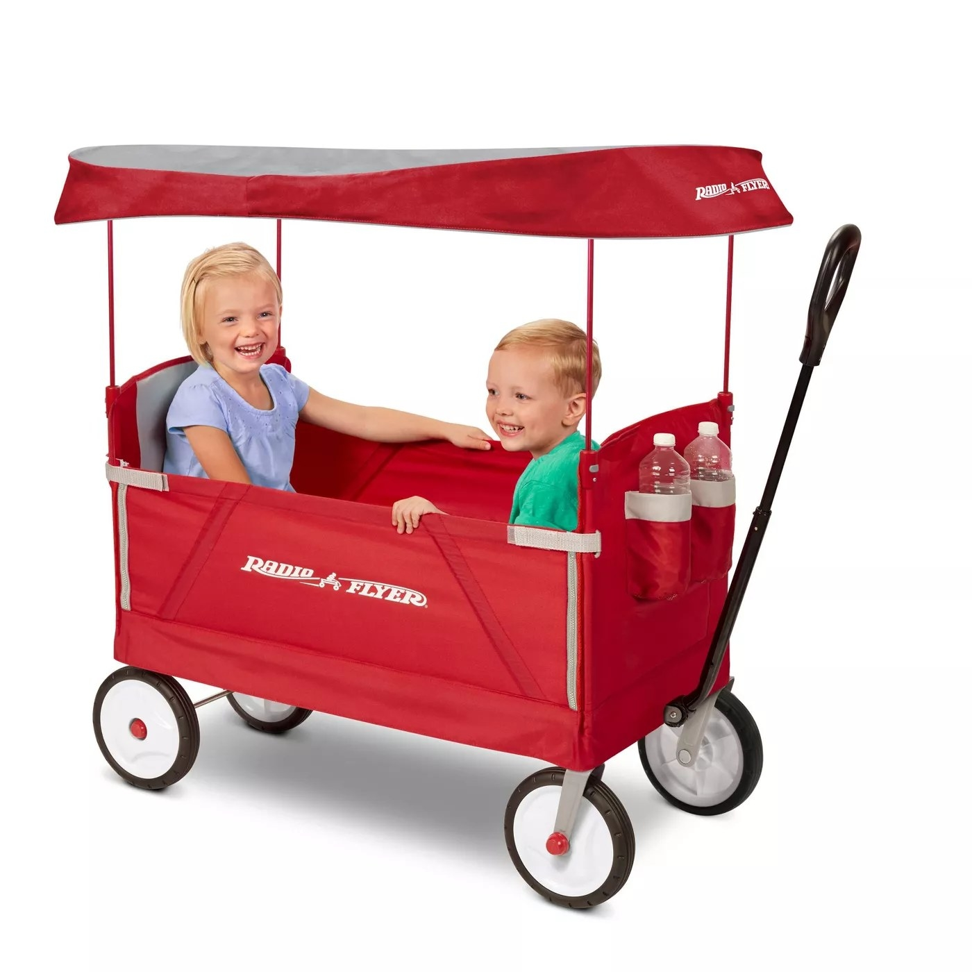 Two children sitting in the wagon
