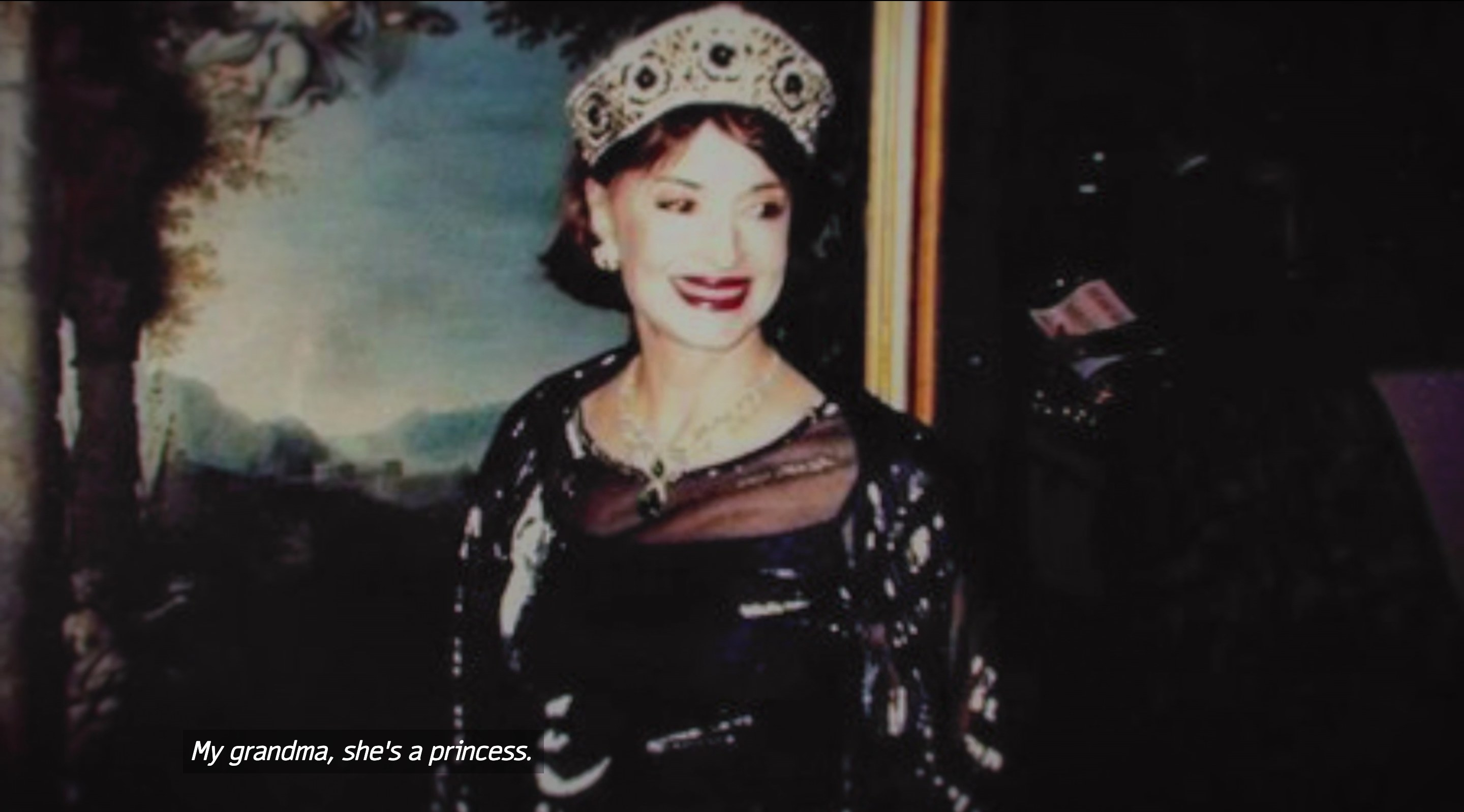 "A woman in a tiara with the subtitle text ""My grandma, she's a princess"""
