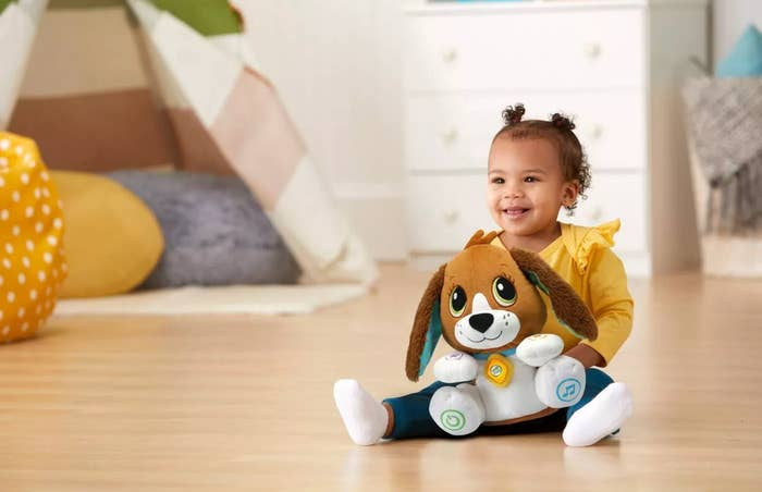 A child with the plush toy