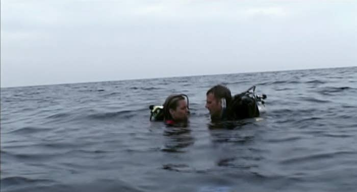 Two people in the middle of the ocean