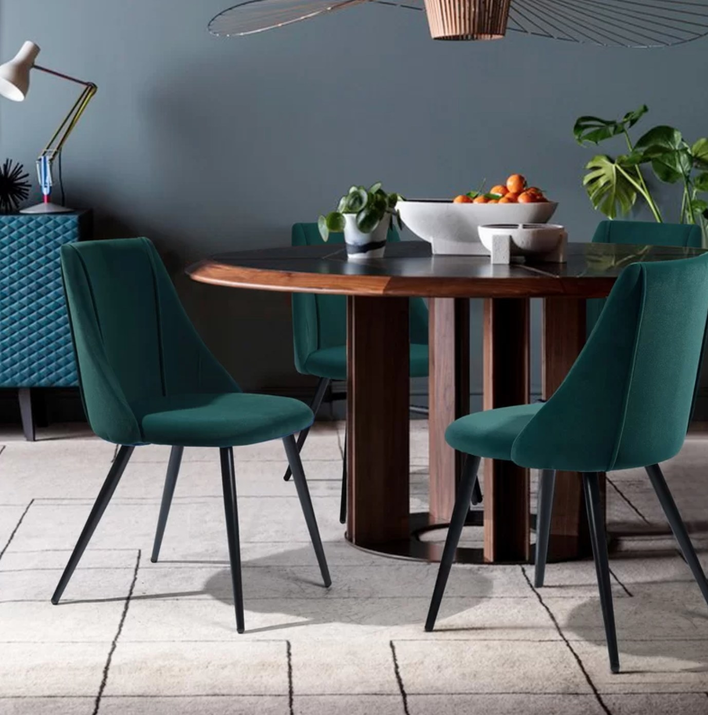 The set of two upholstered side chairs in green