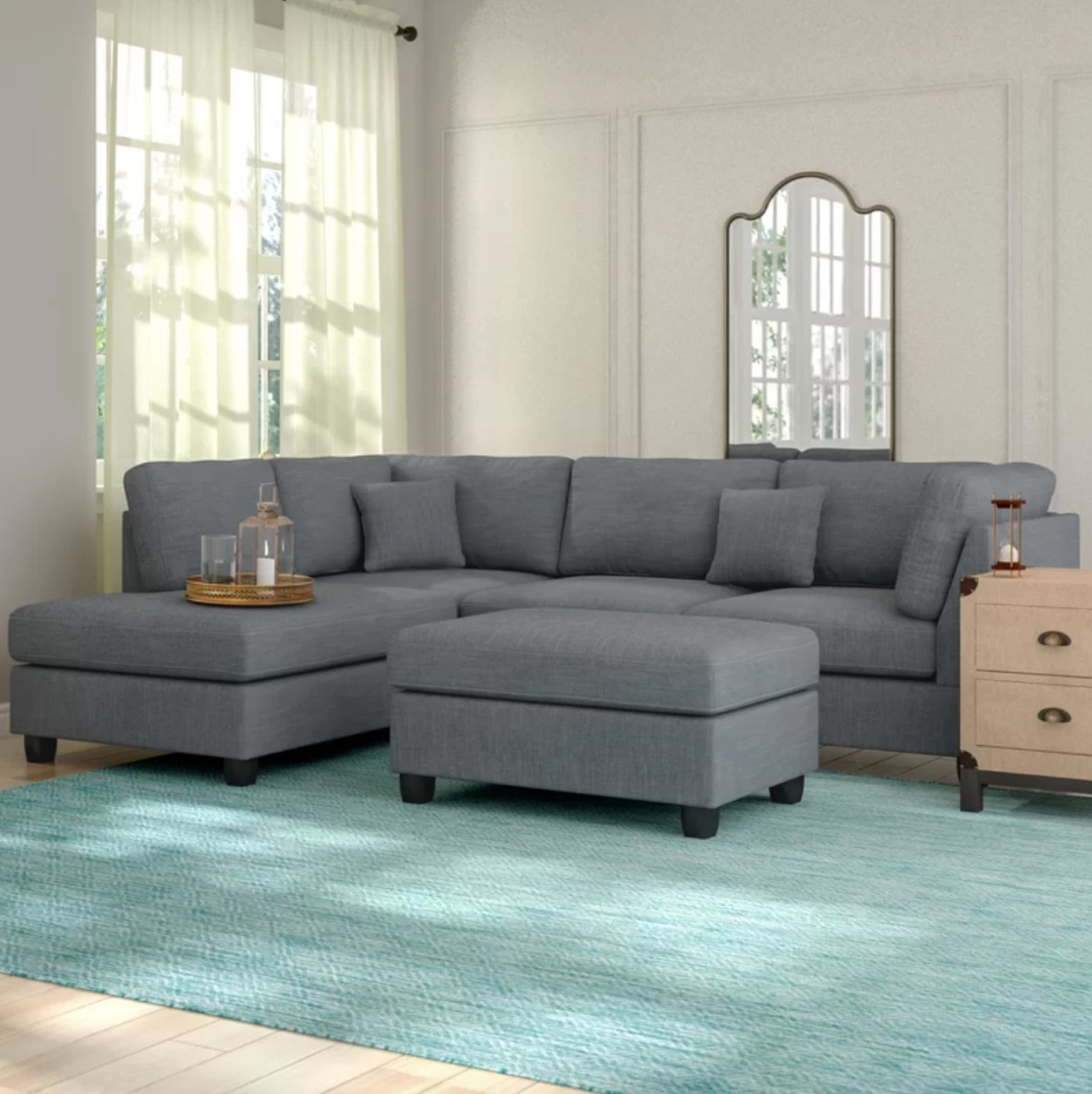 The reversible sectional with an ottoman in gray