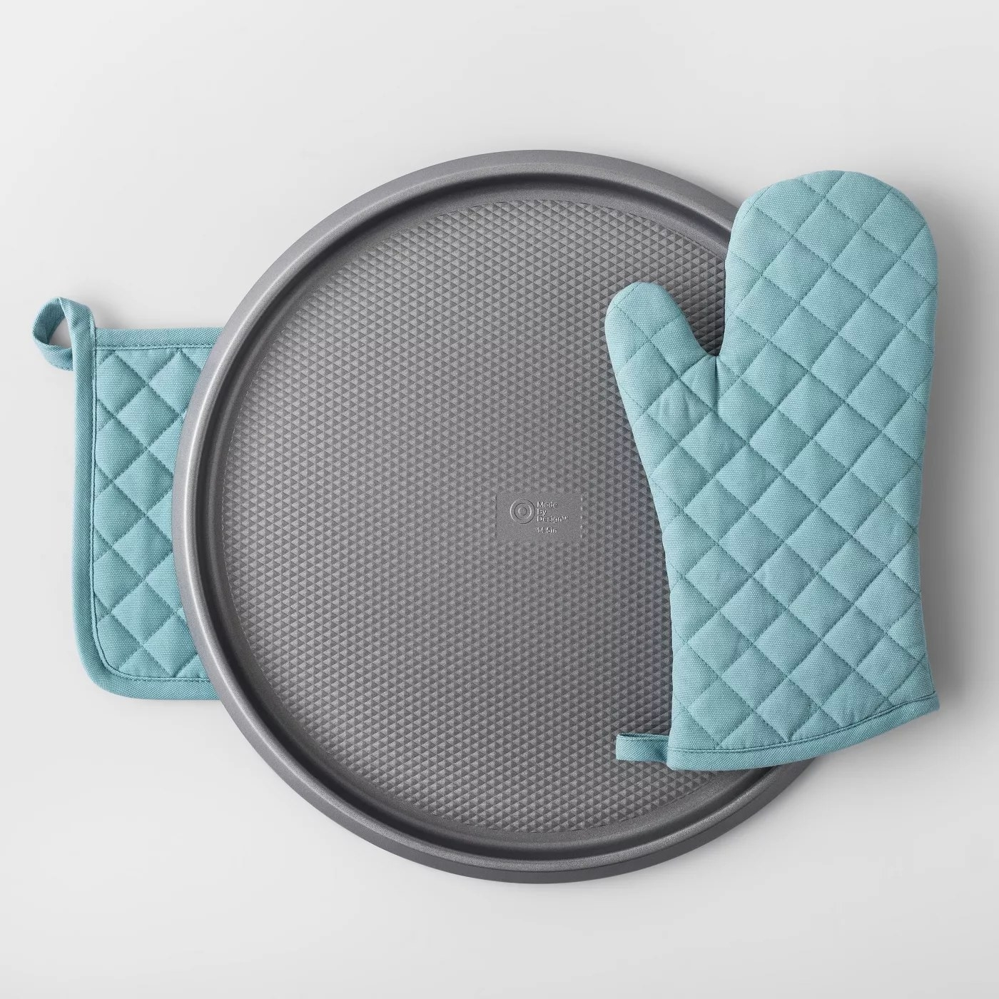 The blue potholder and oven mitt shown with a pizza pan