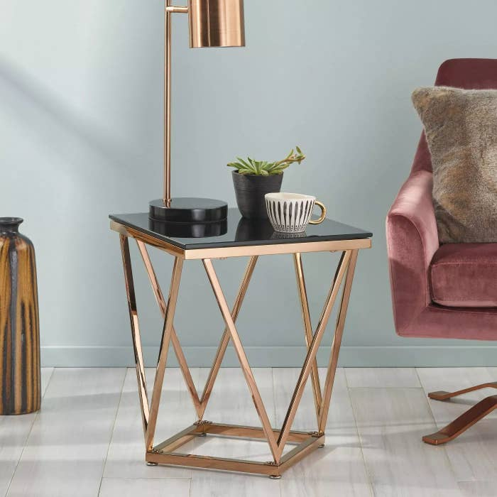The black table with a rose gold frame