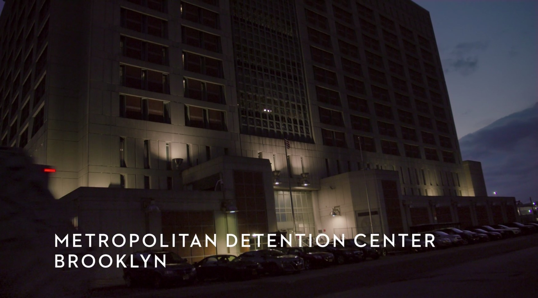"An imposing building and the text ""Metropolitan Detention Center, Brooklyn"""