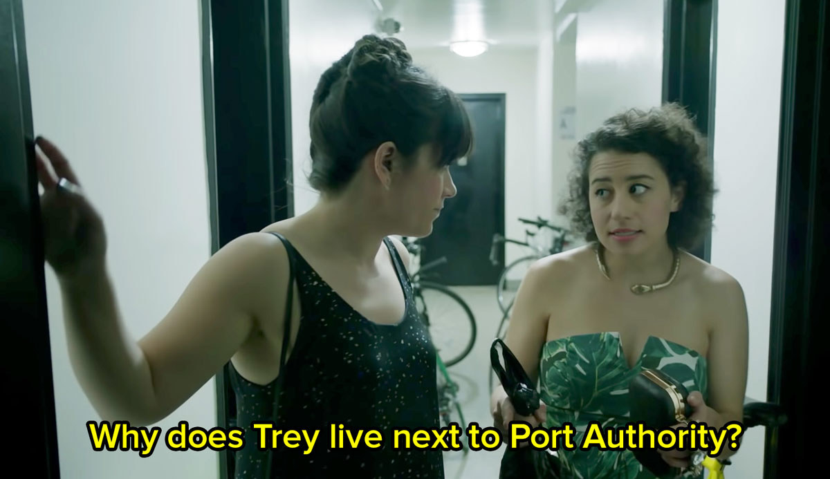 Ilana and Abbi from Broad City stand in a hallway and Ilana says why does Trey live next to Port Authority