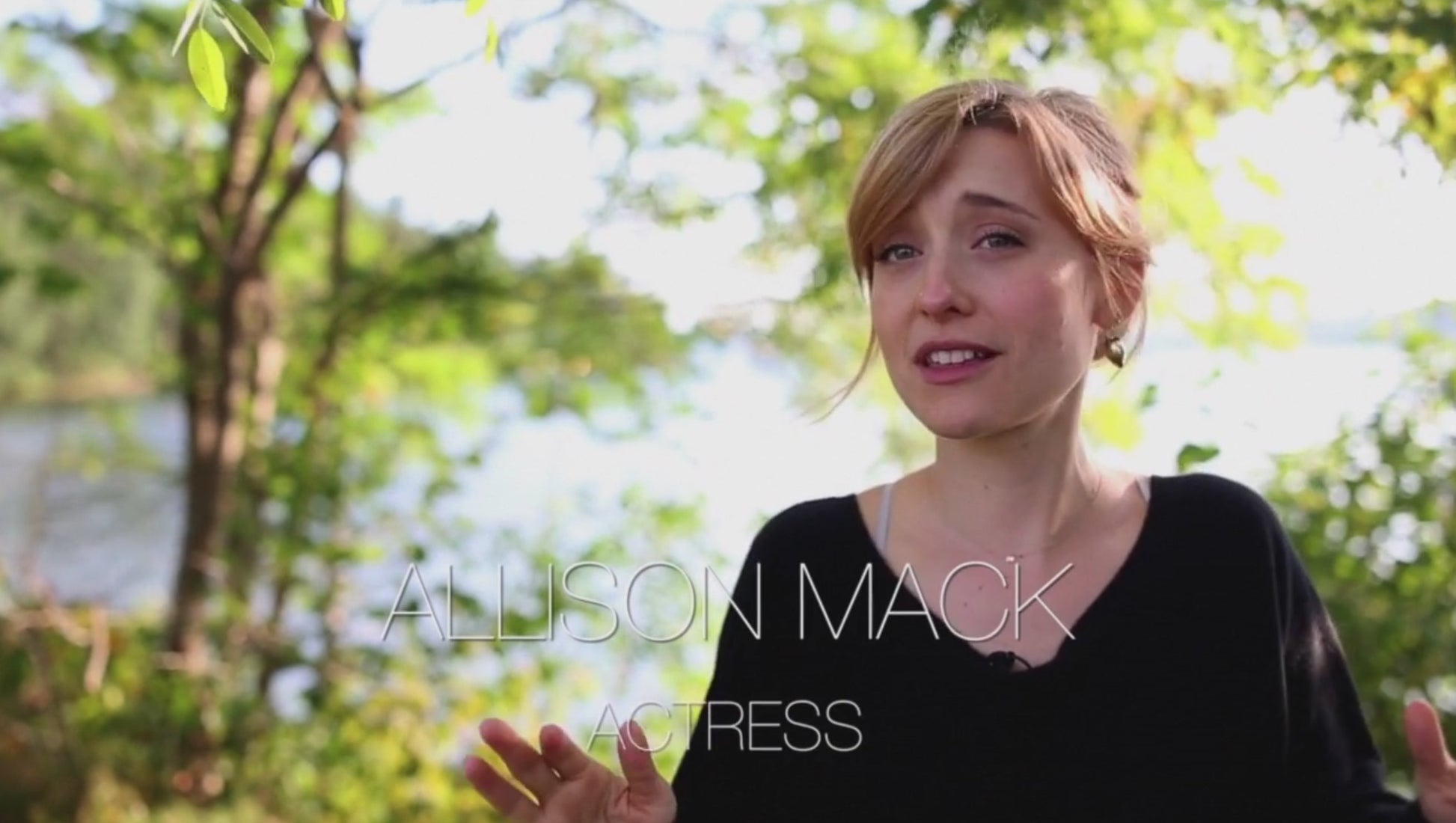 "A woman giving a testimonial, with the text ""Alison Mack, actress"""
