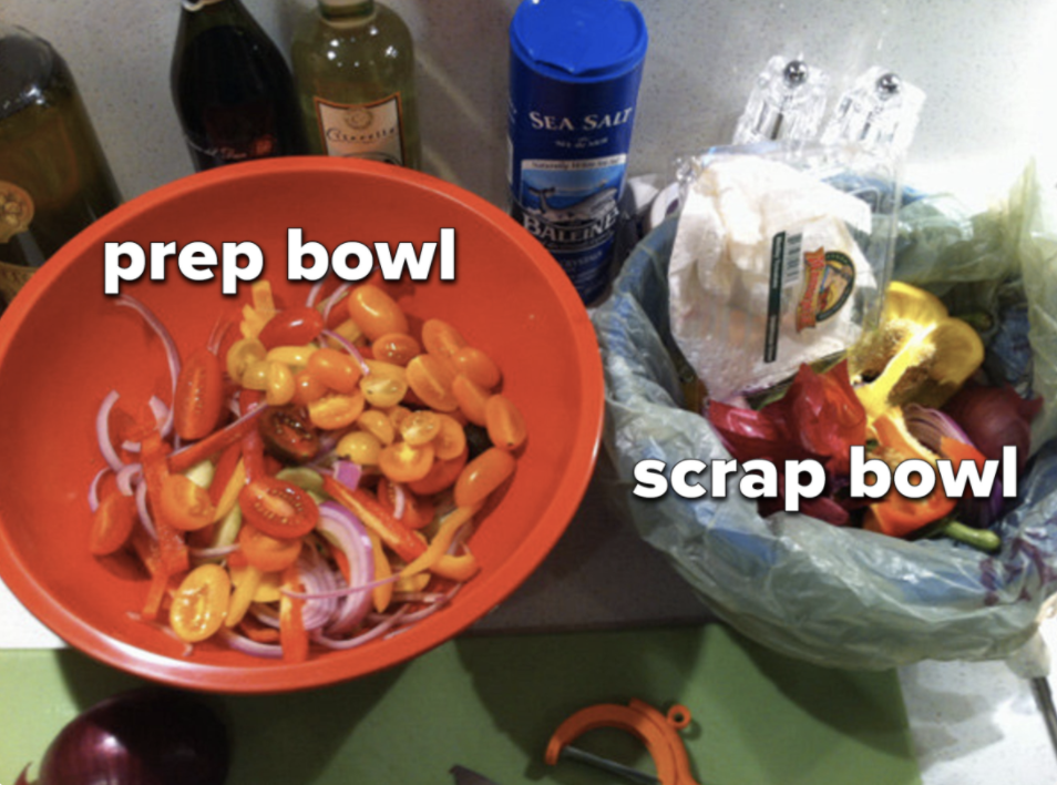 A cooking setup with a designated prep bowl and scrap bowl.