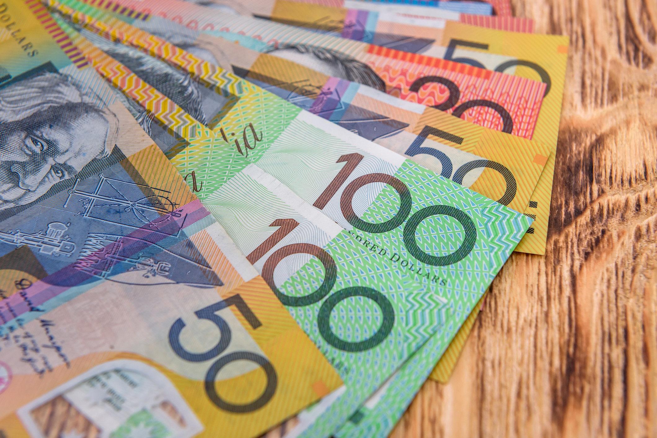 australian $50, $100, and $20 banknotes, which are all different colors
