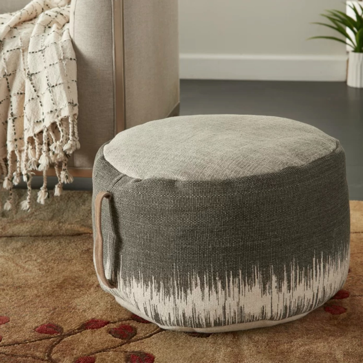 The ottoman pouf in charcoal black/ ivory