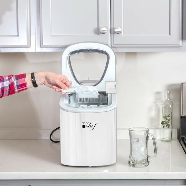 White ice maker with removable ice cube cubby sitting on kitchen counter