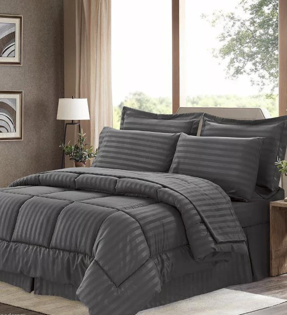 The comforter, pillow shams, and decorative pillows