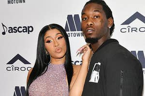 Cardi B and Offset on a press carpet.