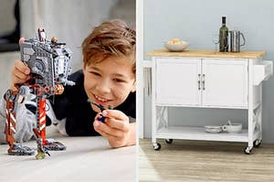 A child playing with a Star Wars LEGO model and a kitchen cart