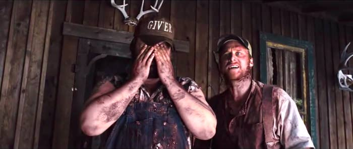 Tyler Labine and Alan Tudyk in Tucker and Dale Versus Evil, both wearing overalls and covering in dirt and maybe blood