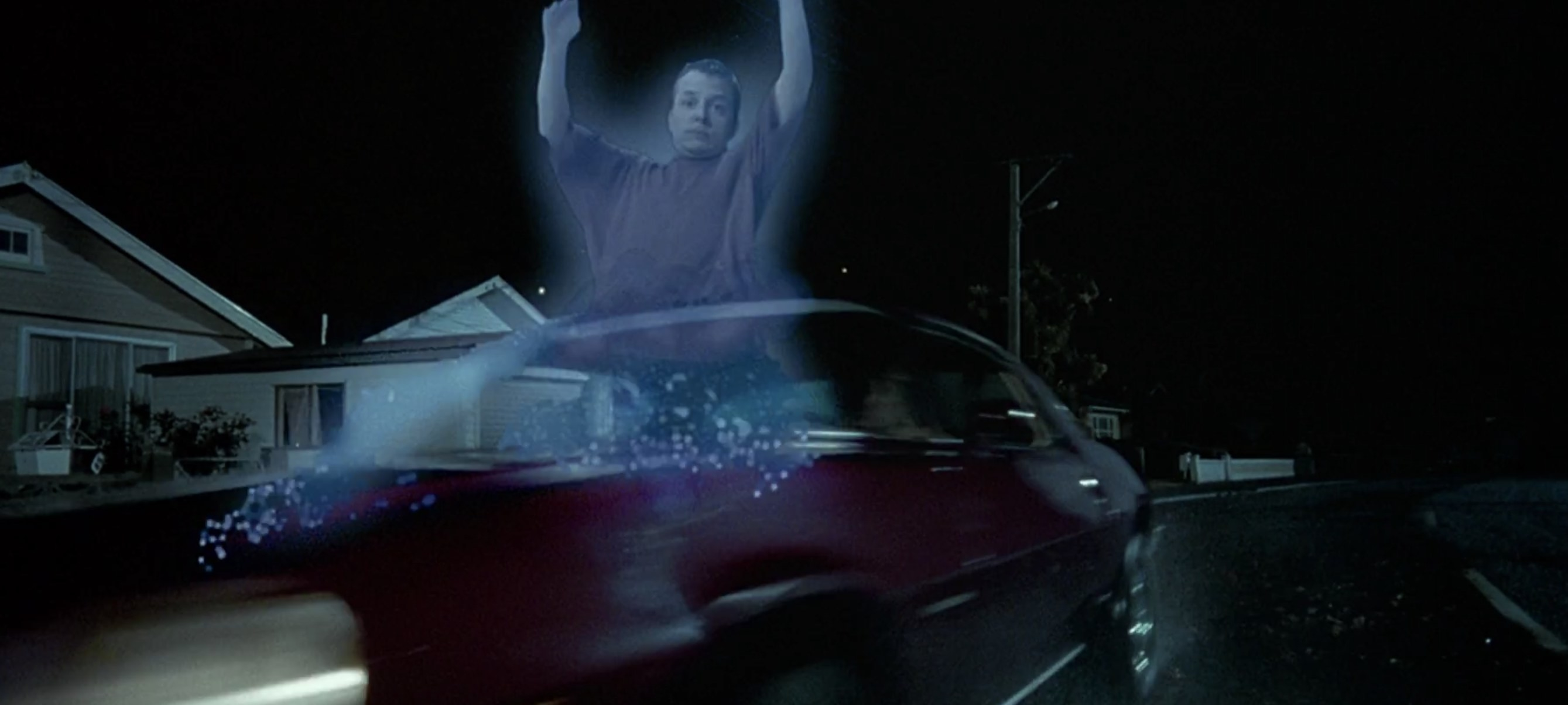 A ghost being run over by a car