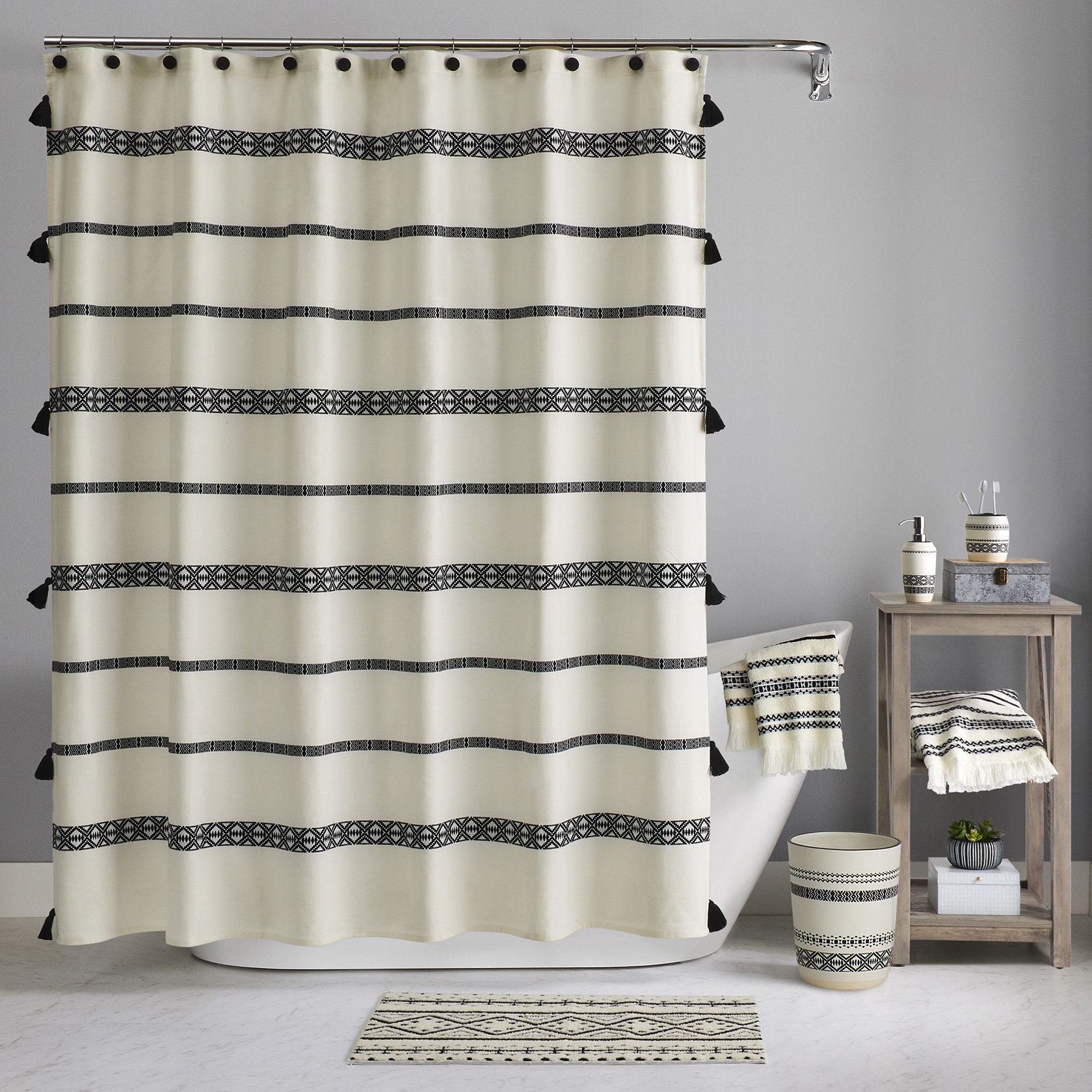 The shower curtain displayed with matching bathroom accessories