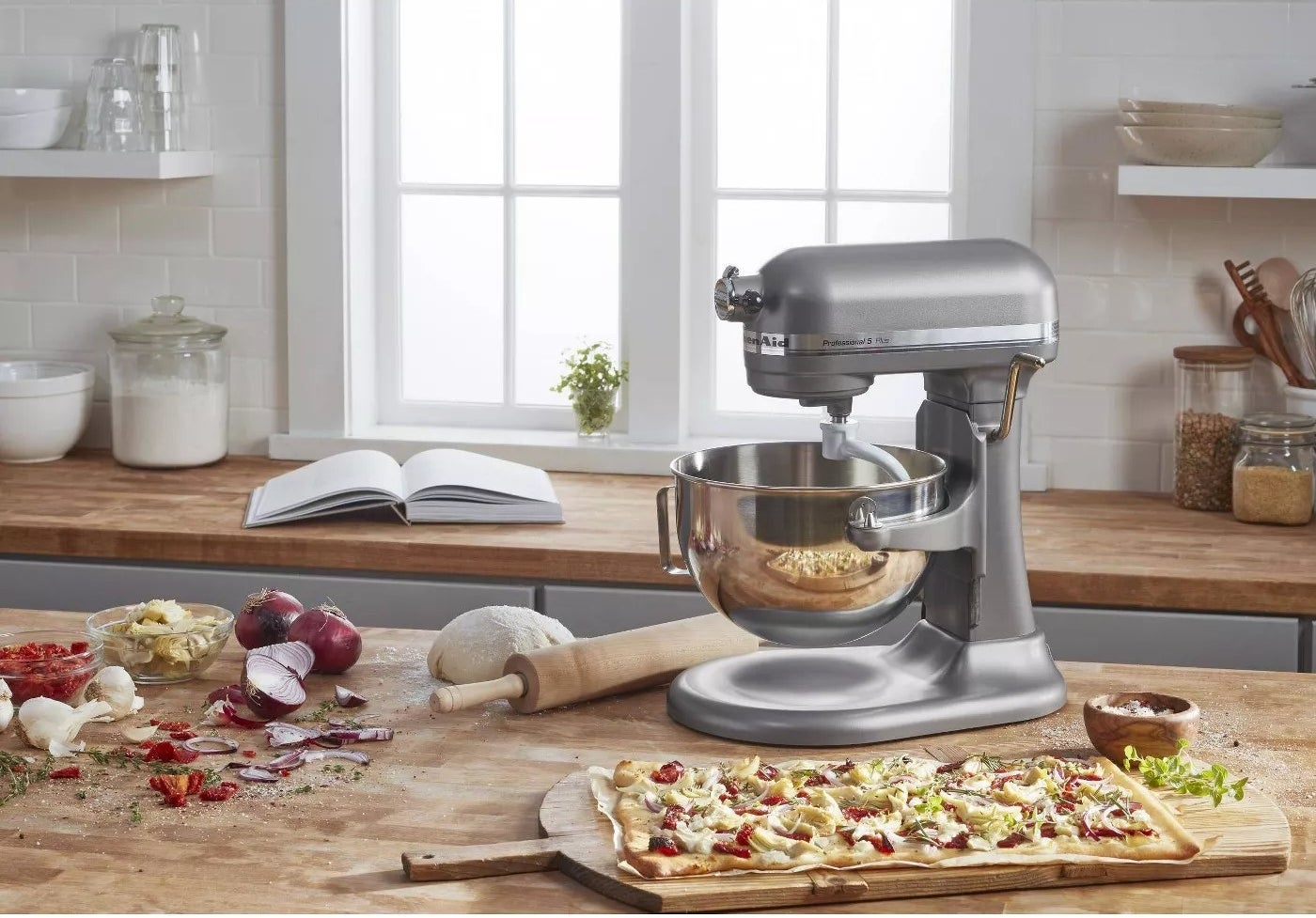 The mixer on a kitchen counter mixing dough