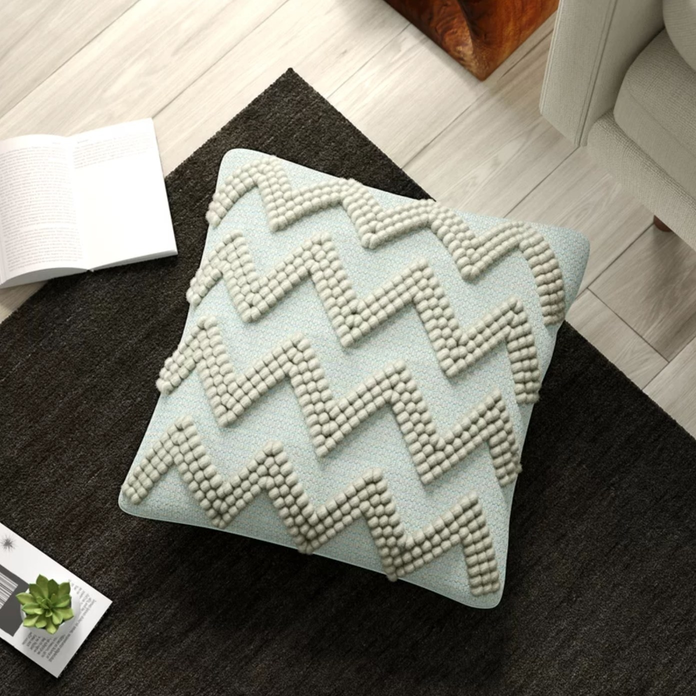 The rectangular pillow cover and insert in celadon