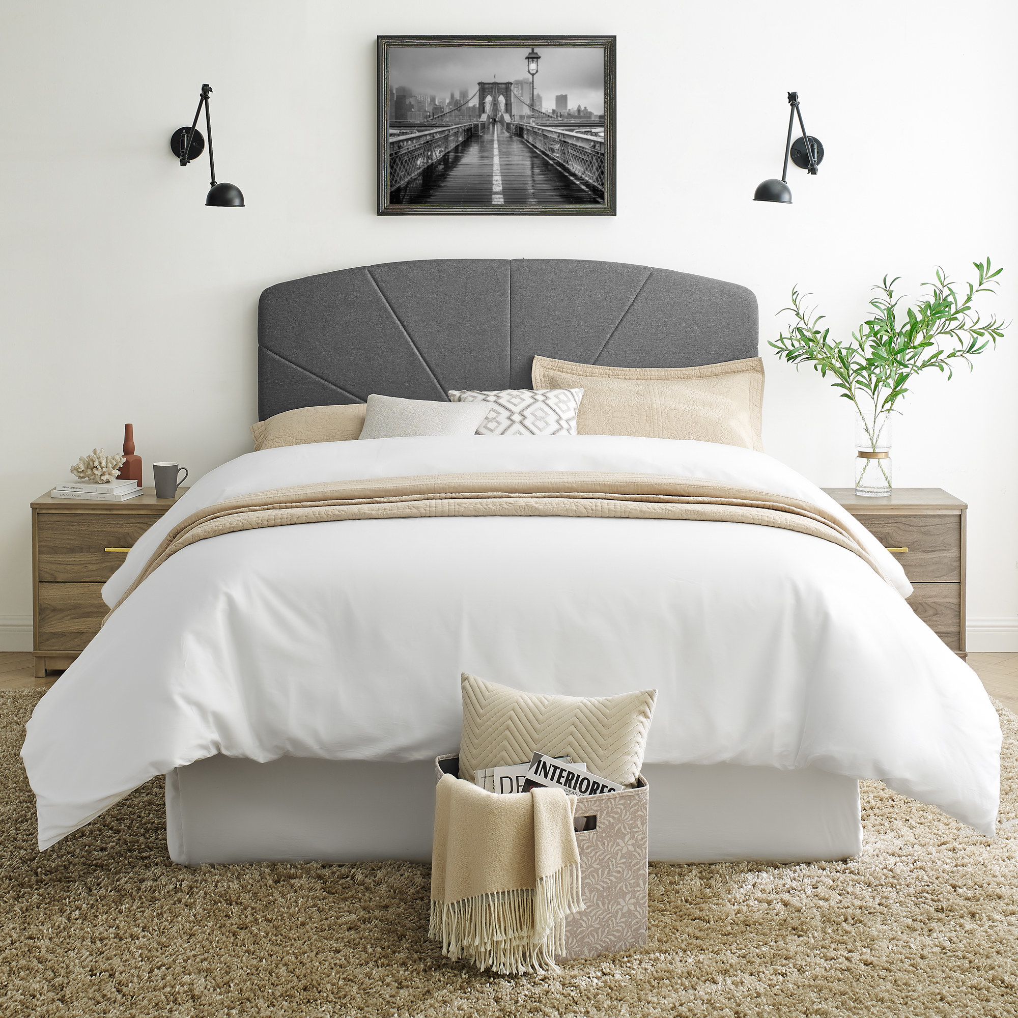 The headboard displayed on a queen-sized bed to show its size and color