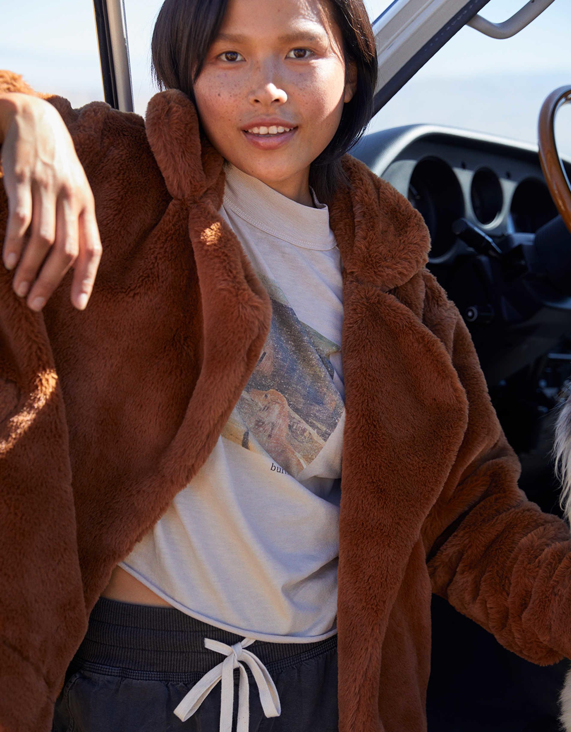 Model wearing the teddy-bear style jacket in brown