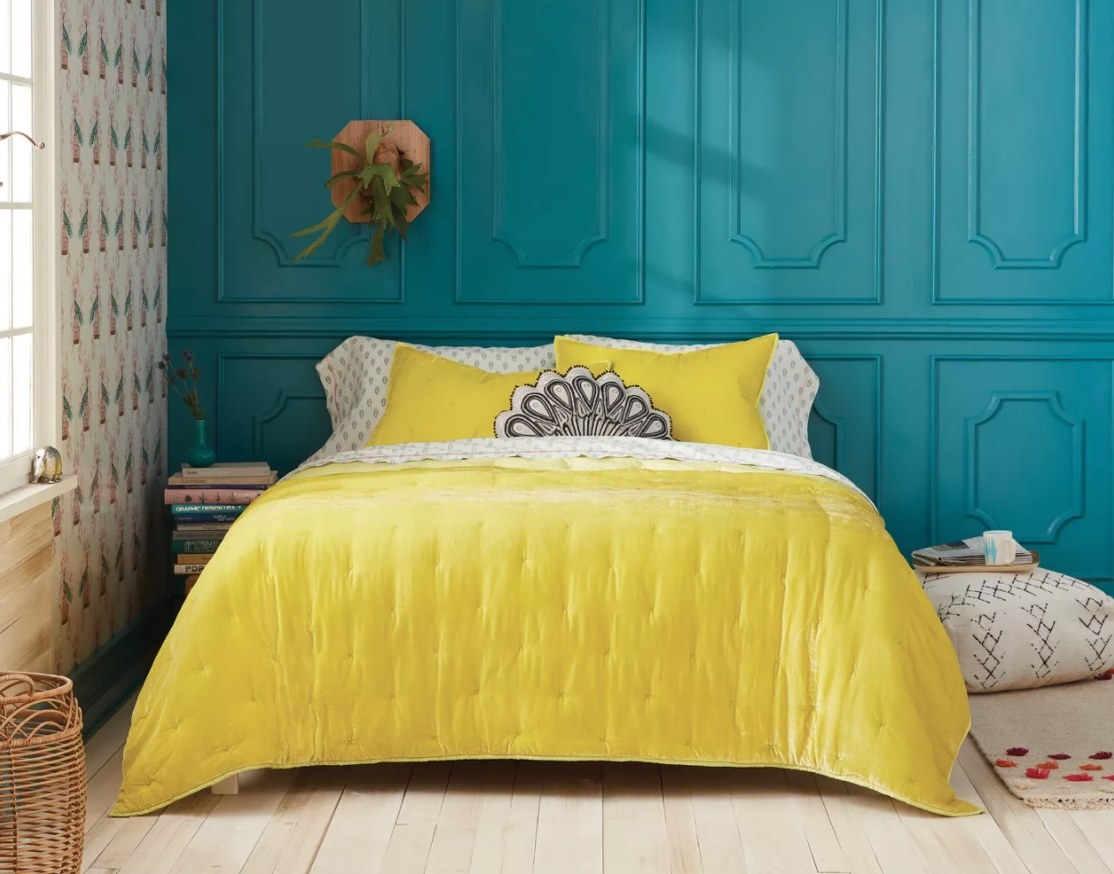 The chartreuse-colored quilt