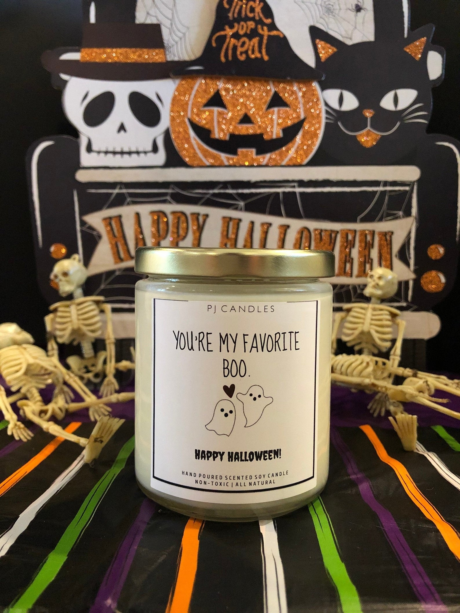 the white candle with ghost design
