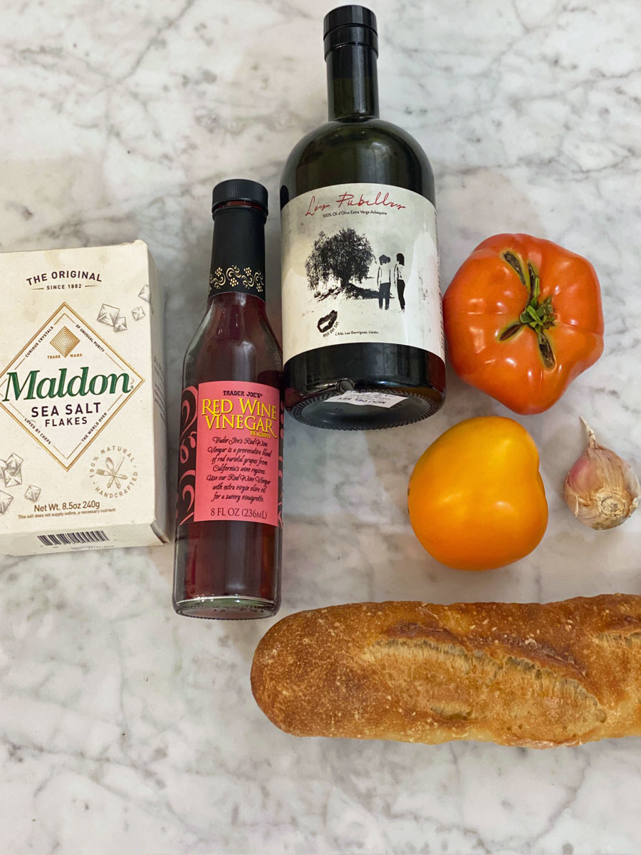 Ingredients for Spanish tomato bread on a countertop.