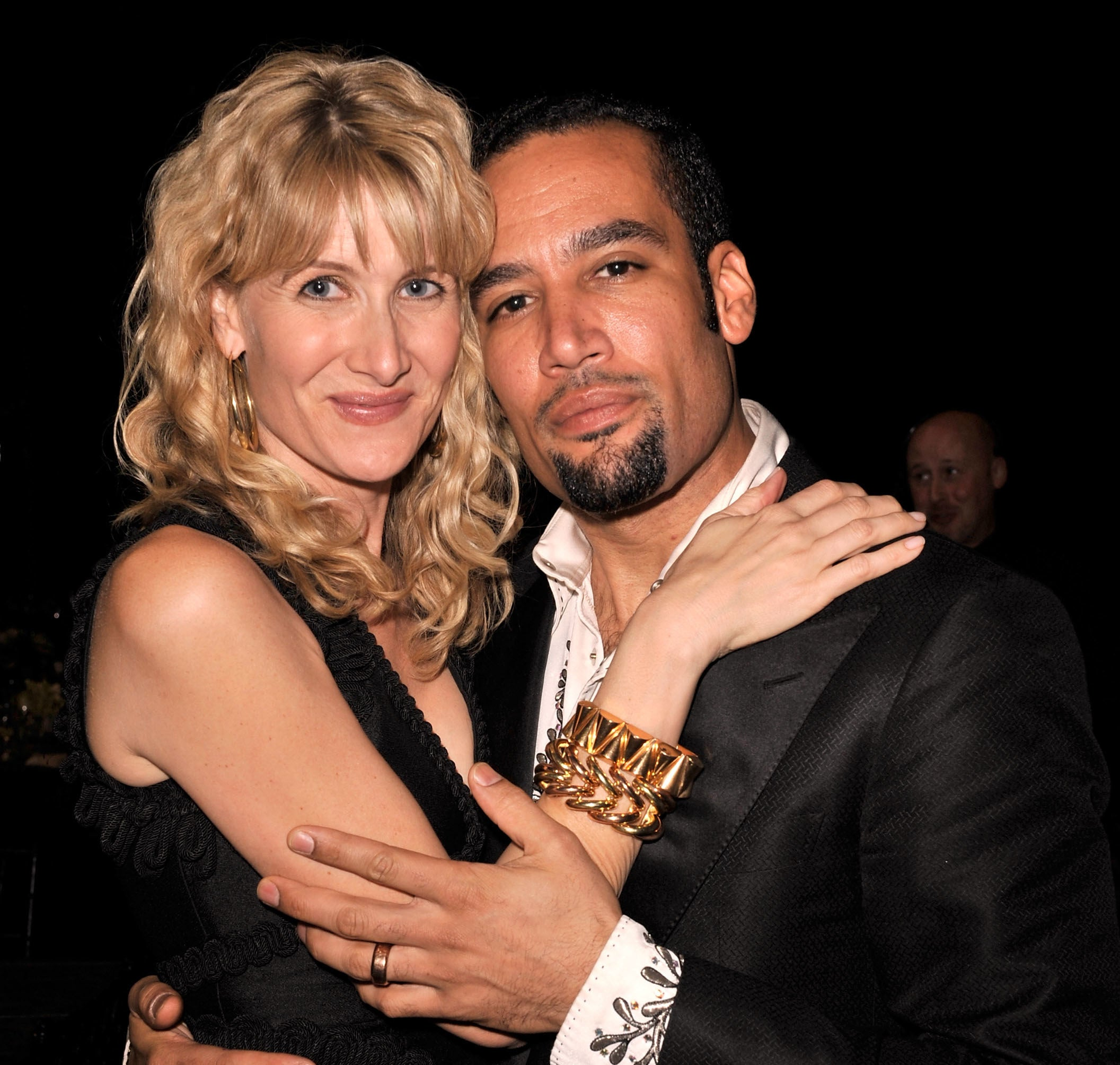 A photo of Laura Dern and Ben Harper hugging at an event