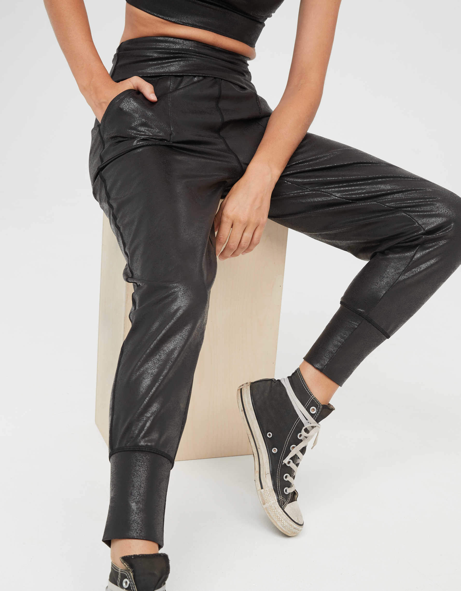 Model wearing the jogger with a sheen to the fabric, foldover waistband, ankle cuffs and pockets
