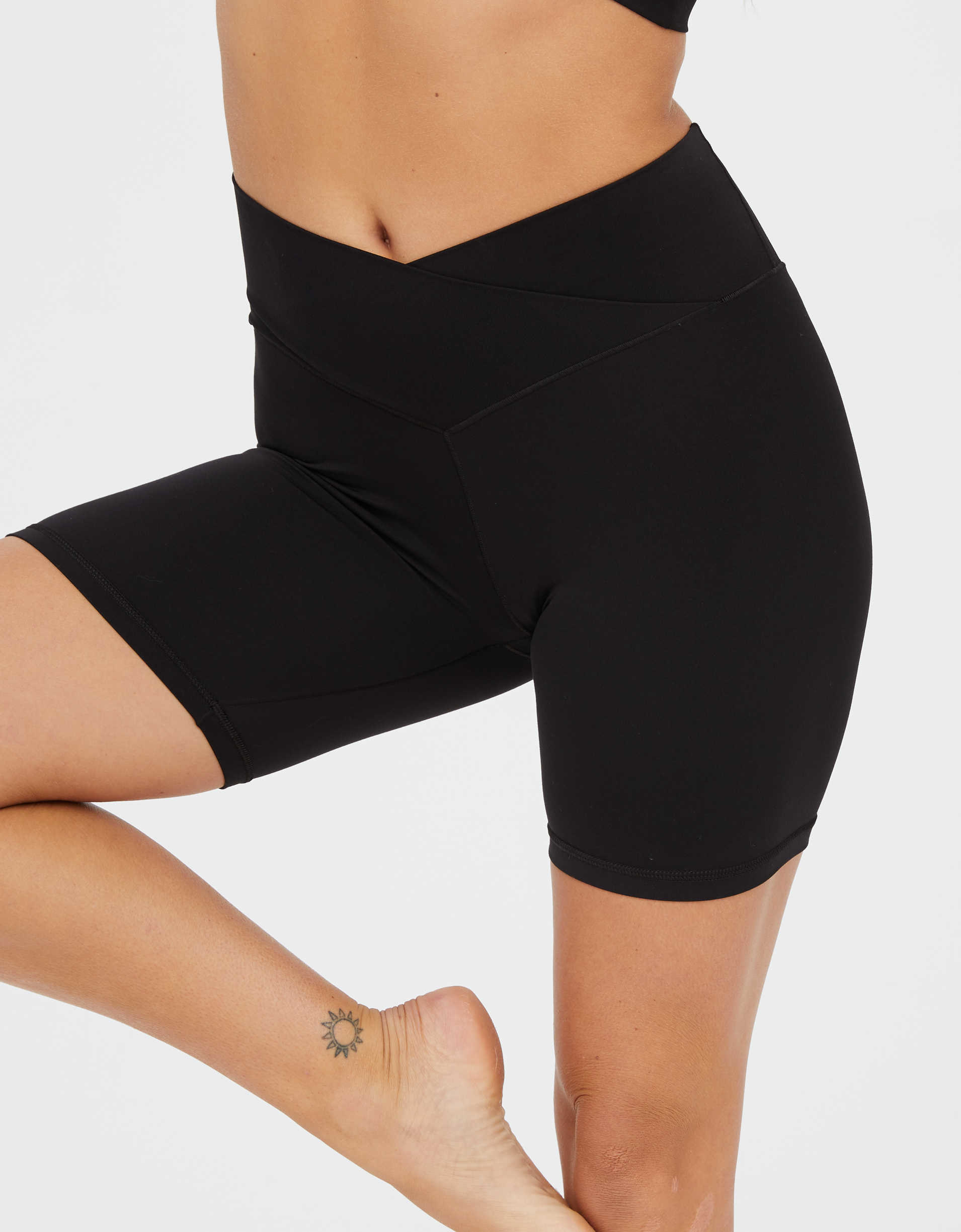 The bike shorts with a crossover waist in black