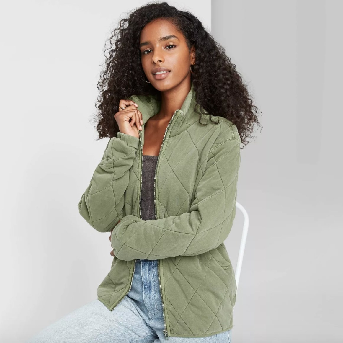 The jacket in the color olive green