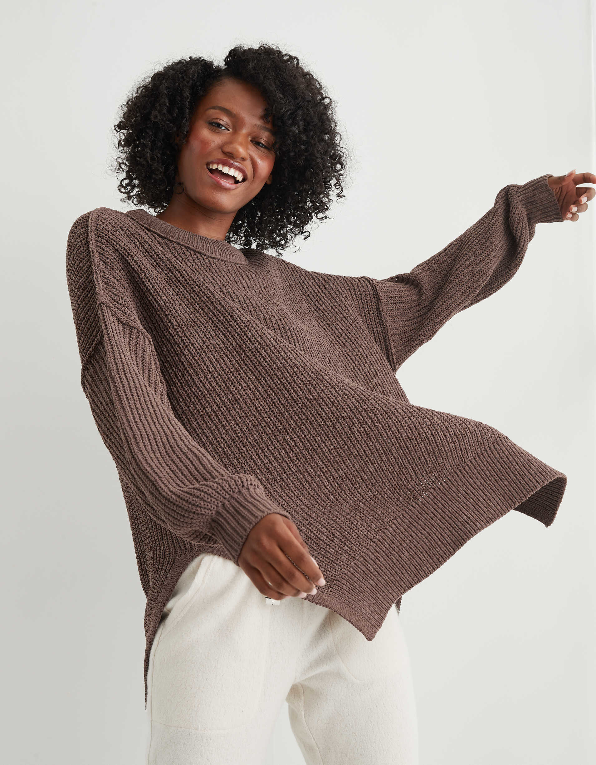 The oversized sweater with a drop shoulder, knit neckline and hems, and slits up the sides in brown