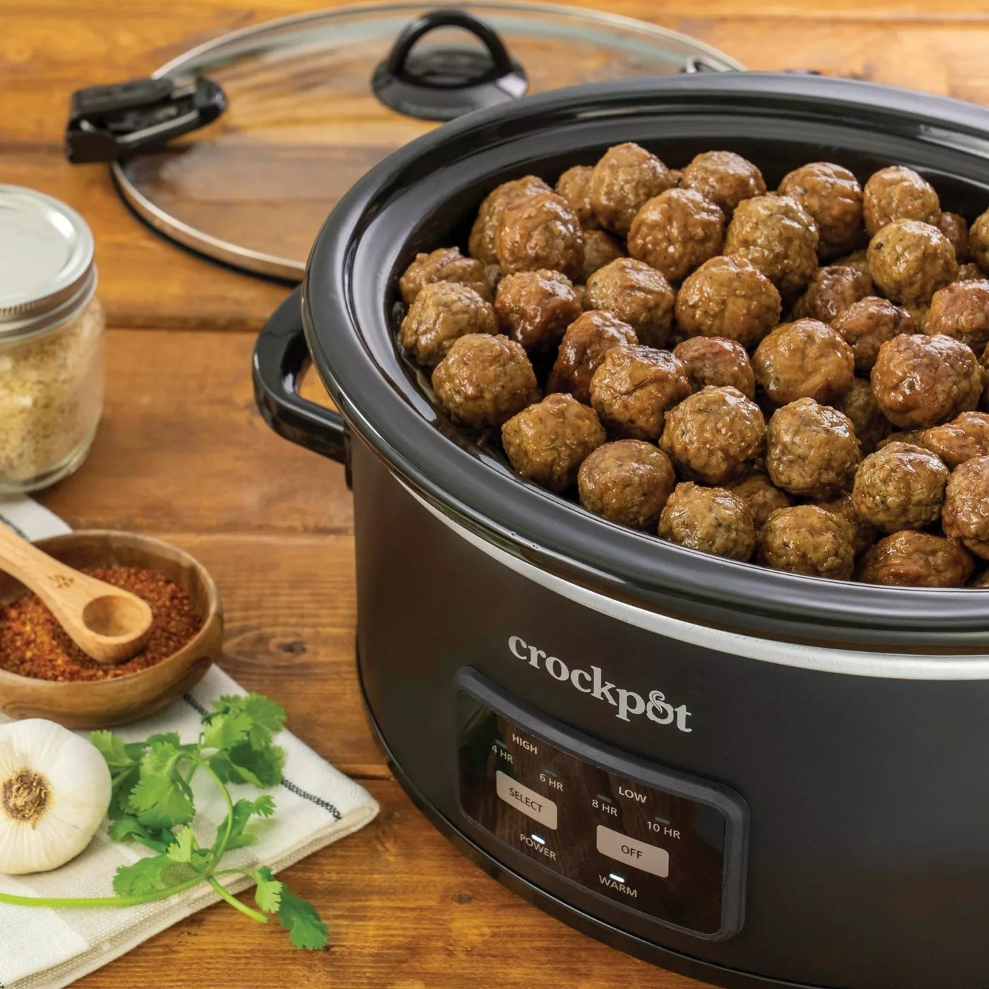 The crock pot filled with meatballs
