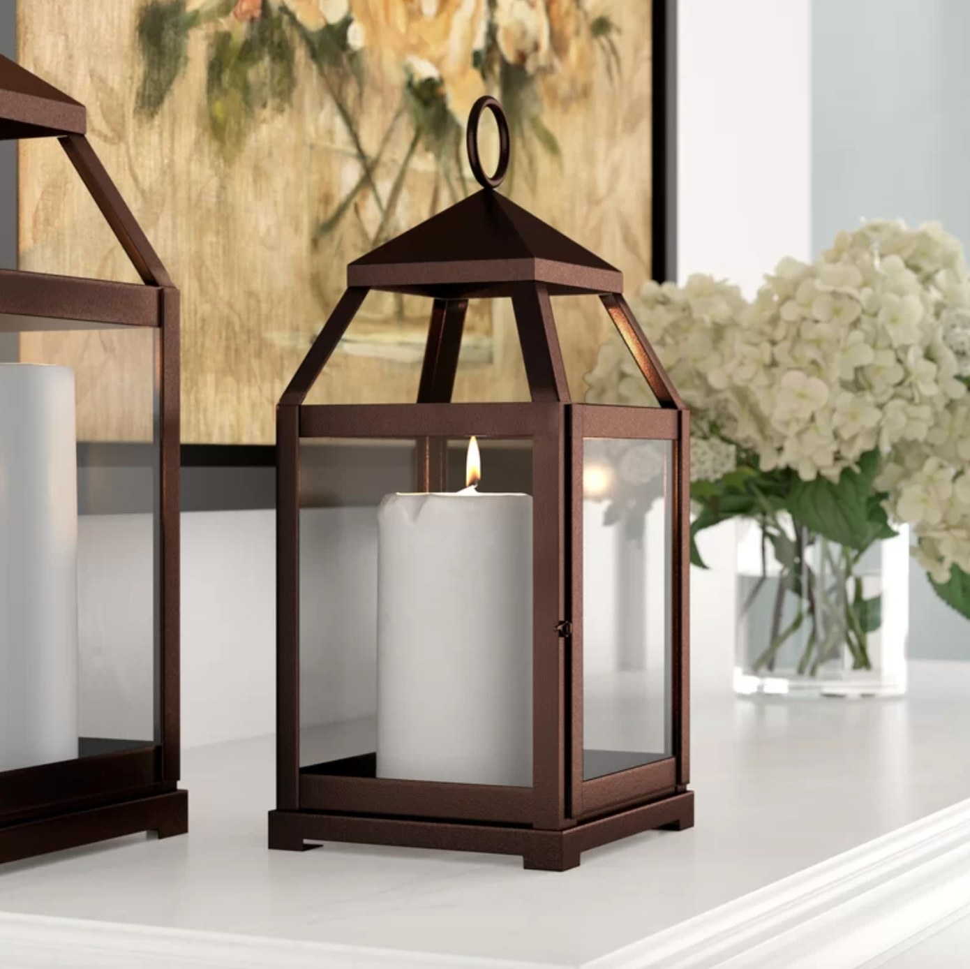The tabletop lantern in bronze with a white candle inside