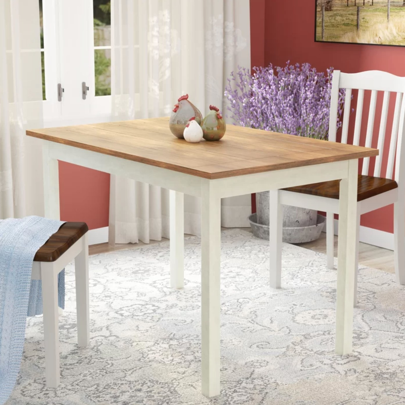 The wood dining table with white legs