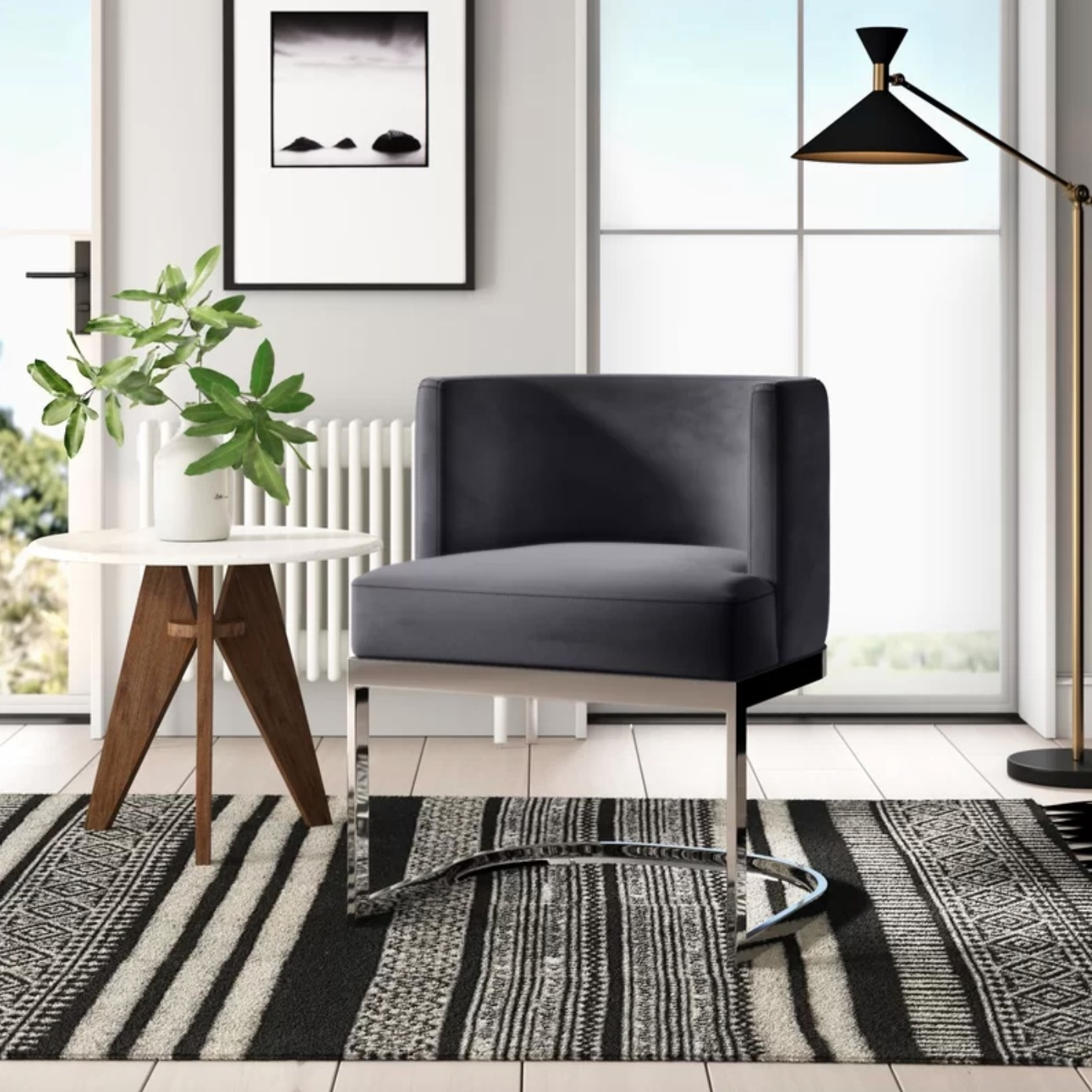 The upholstered dining chair in gray with silver legs