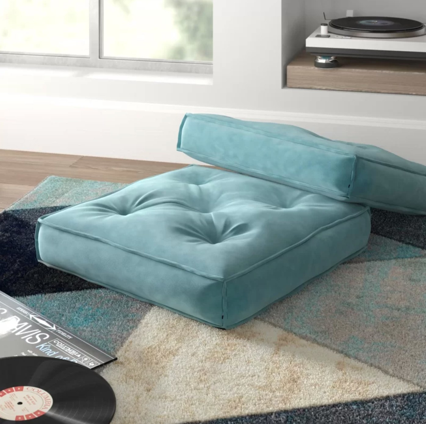 The square pillow cover and insert in teal