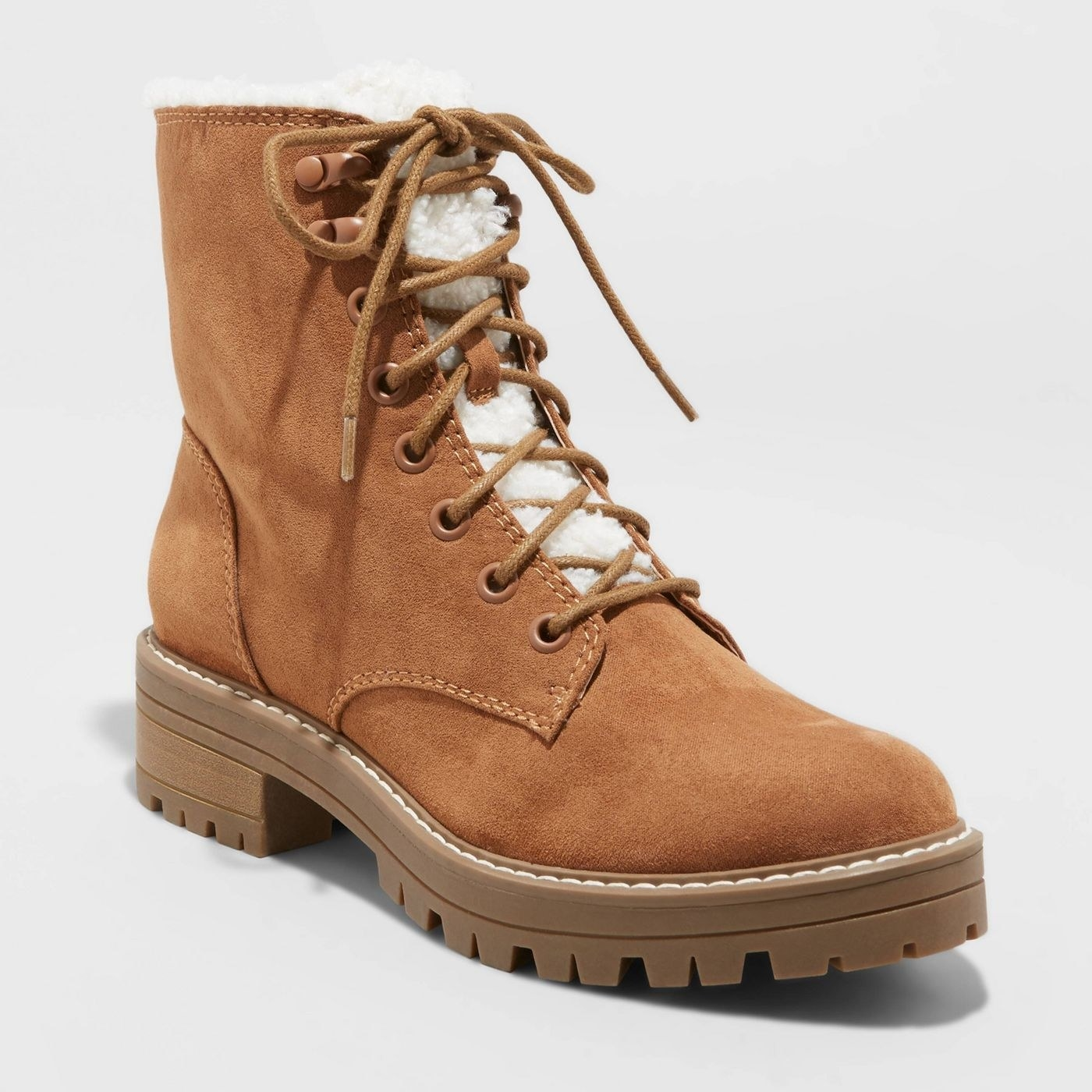 tan laceup hiking booties with a shearling lined tongue