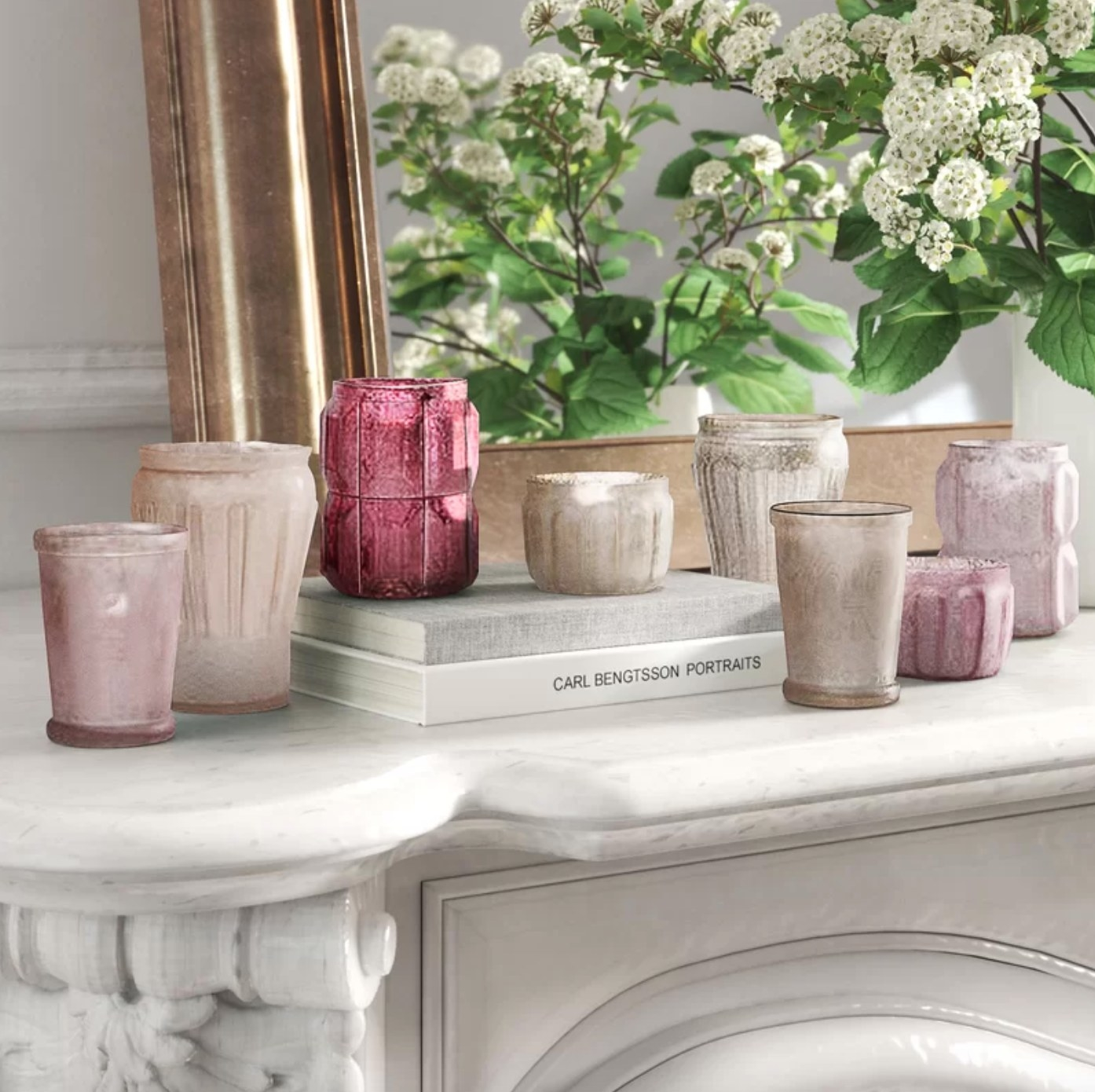 The eight-piece votive tabletop set in hues of plum