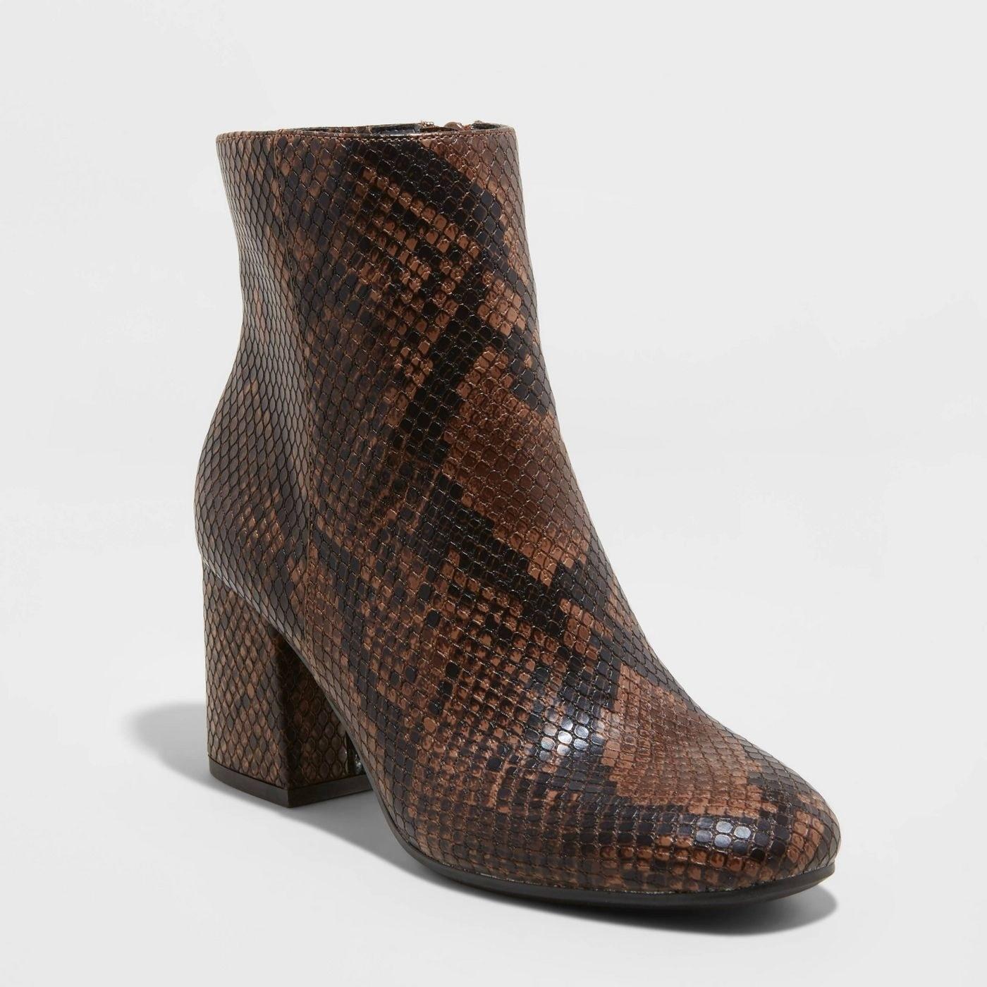 Brown and black snakeskin booties