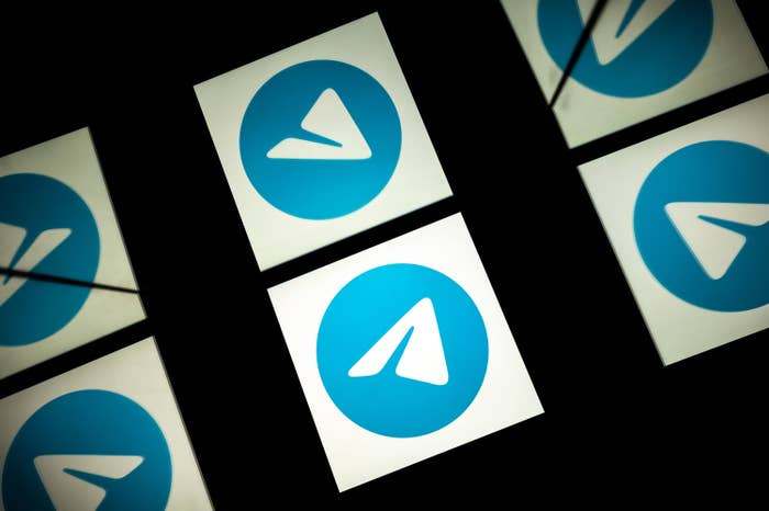 This picture shows the paper plane logo of mobile messaging and call service Telegram on a tablet.