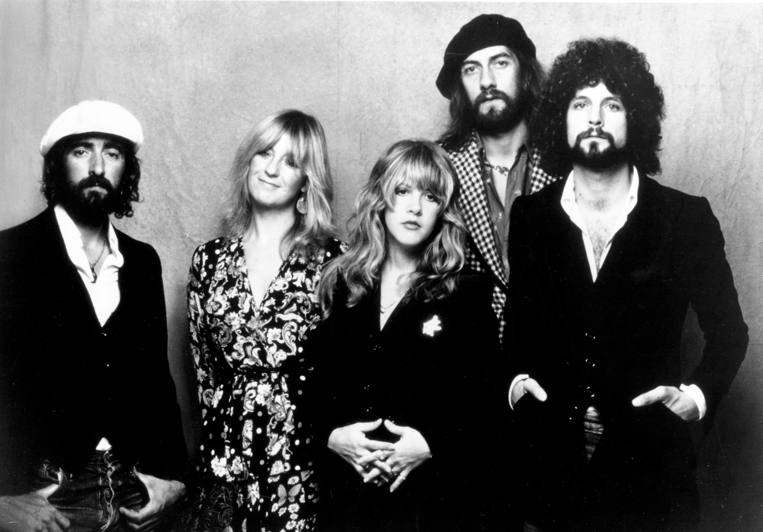 """John McVie, Christine McVie, Stevie Nicks, Mick Fleetwood, and Lindsey Buckingham of the rock group """"Fleetwood Mac"""" pose for a portrait in 1975."""