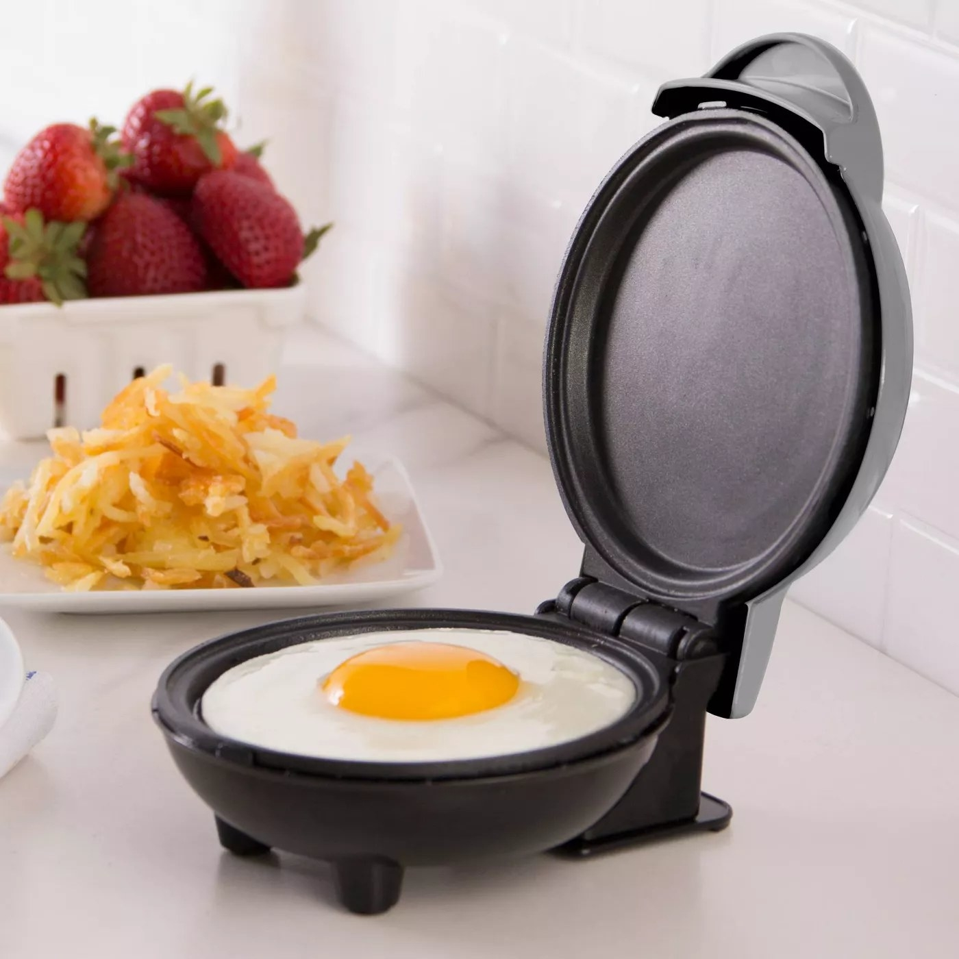 The mini griddle cooking an egg
